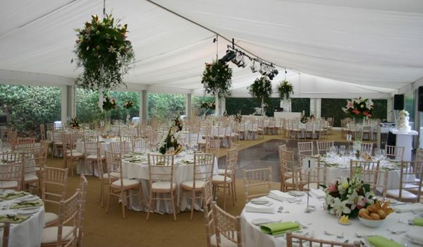12m Clearspan Structure – Flat White Liner & Custom Floral Installation